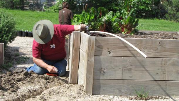Adding drip irrigation to a raised vegetable bed