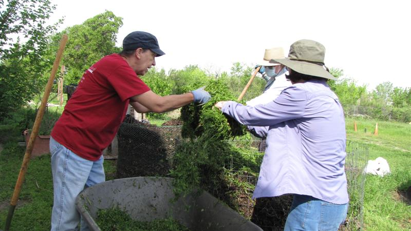 Master Gardeners Working with Compost
