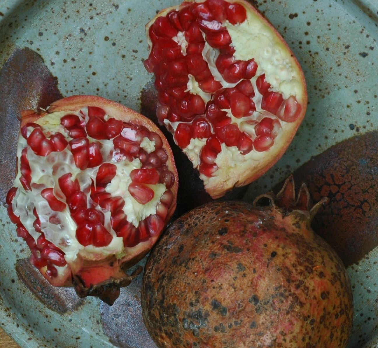 Pomegranate harvested from our tree, pottery by Lisa's daughter