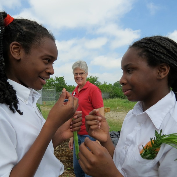 Fifth Graders From West Dallas Community School and Dallas County Master Gardener, Abbe in background