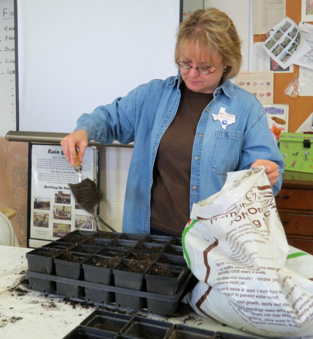 Above: Michele using soil mix for seed starting