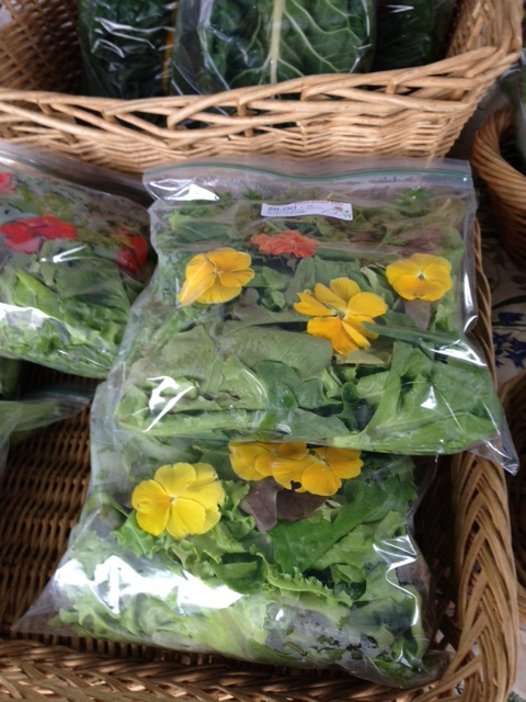 Above: Organic nasturtium blossoms bundled  up and for sale at the Aspen, Colorado Summer market