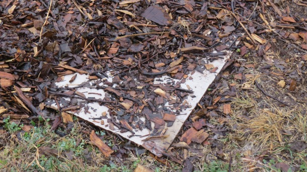 Cardboard Peeking Out From Under Mulch, More Mulch to be Added